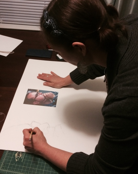 Laura works on a sketch of her Art Lotto partner, Greg Sultan.